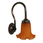 """Manufactured in Ireland, this quality brass wall light comes complete with amber bell glass shade."""