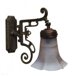 """Manufactured in Ireland, this quality solid brass wall light comes with a bell shade."""