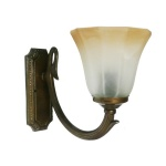 """Manufactured in Ireland, this quality brass wall light comes with bell glass shade."""