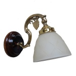 """Manufactured in Ireland, this quality brass wall light comes with a cream bell glass shade and wooden back plate."""