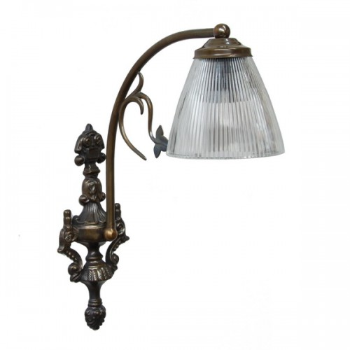 """""""Manufactured in Ireland, this brass wall light comes with a holophane glass shade which when lit creates a lovely warm glow and looks great in any traditional style setting."""""""