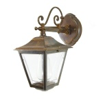"""""""This traditional cast brass outdoor wall light looks great when lit with an edison filament bulb."""""""